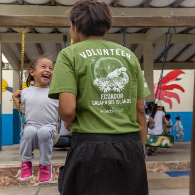 A childcare volunteer in Ecuador supervises children during playtime